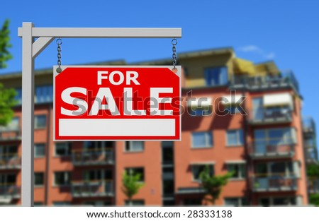 Real estate sign in front of newly built condos - stock photo