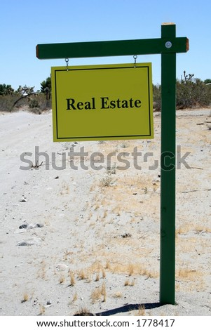 Real Estate Sign in the desert - stock photo