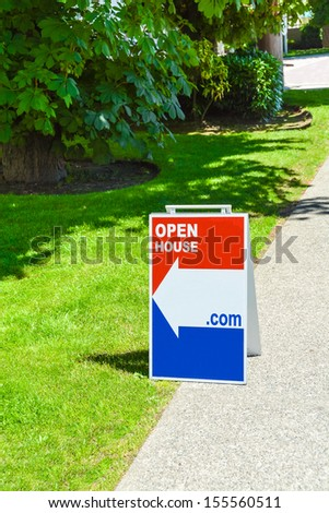 "Real Estate Sign ""Open House"" on a pavement site. - stock photo"