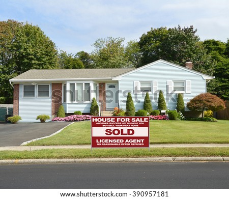 Real estate sold (another success let us help you buy sell your next home) sign Beautiful Landscaped Suburban Ranch Style Home Residential Neighborhood USA - stock photo