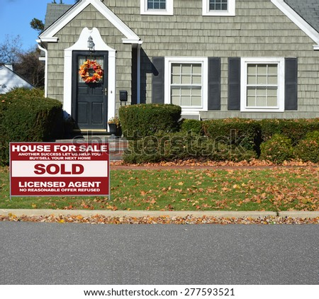 Real estate sold (another success let us help you buy sell your next home) sign Close up of Beautiful Home Leaf wreath Sunny autumn day residential neighborhood USA