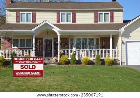 Real Estate sold (another success let us help you buy sell your next home) sign Suburban high ranch style home residential neighborhood USA