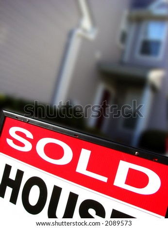 Real estate sold rider insert on a realtor advertising sign in front of a house for sale - stock photo