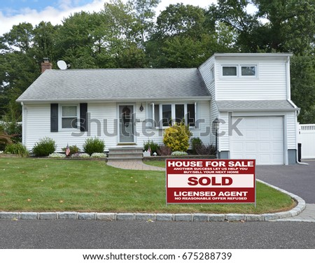 Real Estate sold sign Suburban bungalow home USA