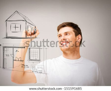real estate, technology and accomodation concept - man drawing house and blueprint on virtual screen - stock photo