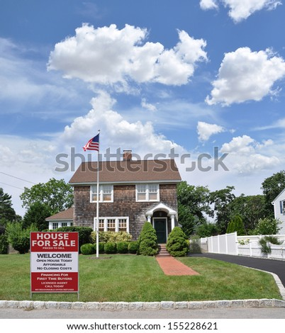 Real Estate Welcome Open House For Sale Sign Affordable No Closing Costs on Front yard lawn of Gable Style Suburban Home American Flag Waving Blue Sky Clouds USA - stock photo
