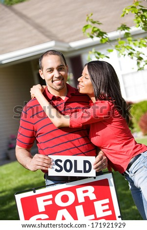 Real Estate: Woman Hugs Man After Buying Home - stock photo
