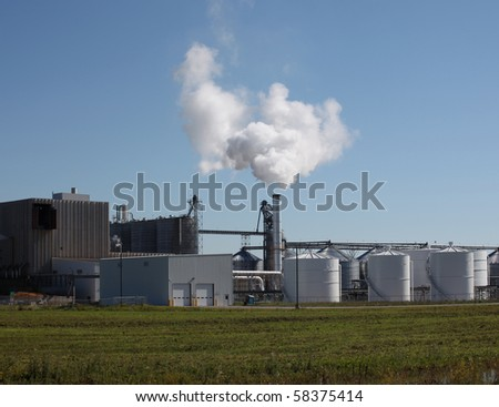 Real Factory and Smokestack - stock photo