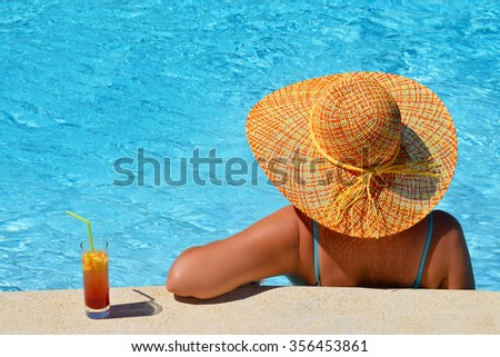 Real female beauty enjoying her summer vacation at swimming pool - stock photo
