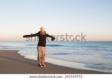 Real Female hairless fight against cancer at the beach - stock photo