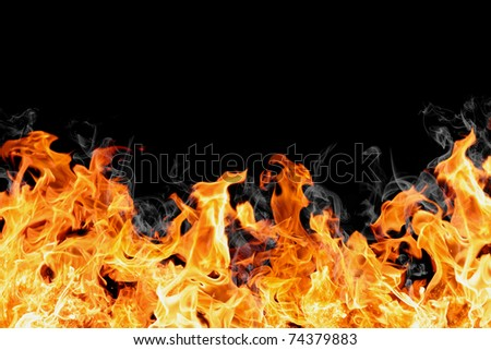 real fire wall isolated on black - stock photo