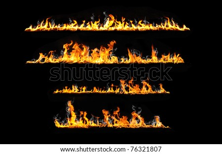real flames isolated on black - stock photo