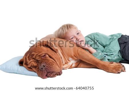 Real friendship - Thoughtful Boy Lying on Huge Sleeping Dog, Isolated - stock photo