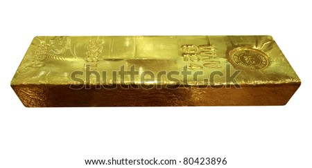 Real gold ingot on white background isolated