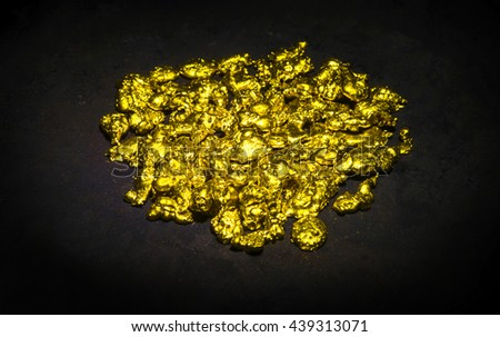 Real golden nuggets isolated on black background. - stock photo