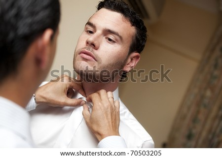 Real groom moments before his wedding - stock photo