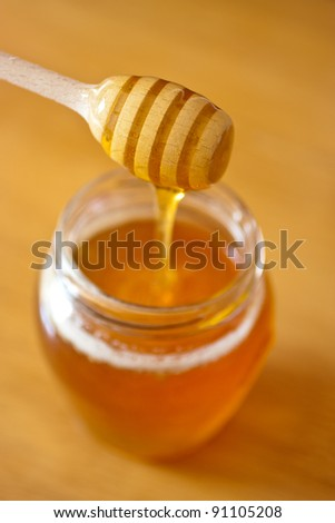 Real honey in a jar. Artistic selective focus. - stock photo