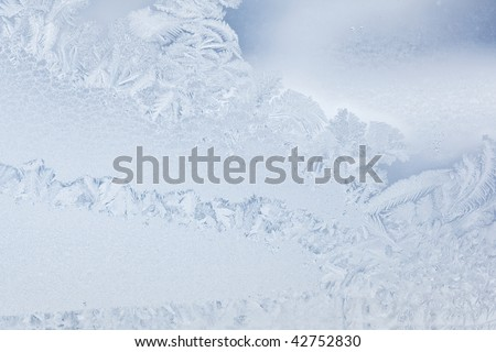 Real Ice flower frosting on the glass of the window - stock photo