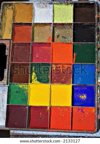 Real-life painter palette of a working artist in action - stock photo