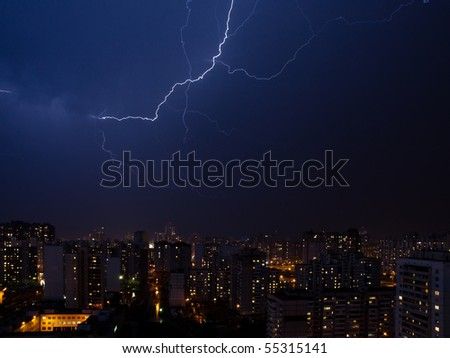 Real lightning bolt strike in a city - stock photo