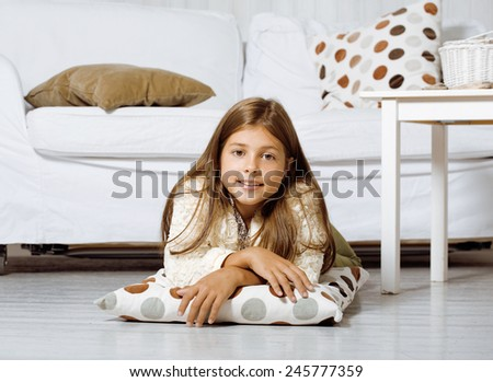 real little cute brunette girl at home smiling close up - stock photo