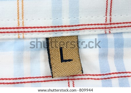 real macro of clothing label - SIZE L - stock photo