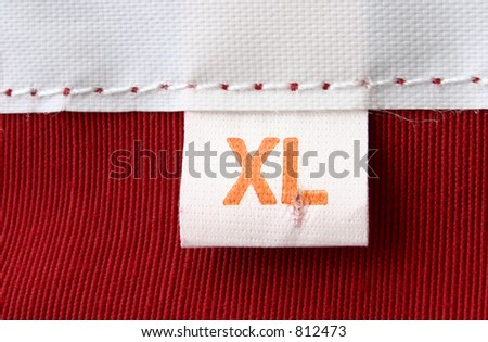 real macro of clothing label - SIZE XL - stock photo