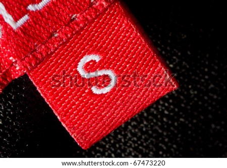 real macro of s size clothing label - stock photo
