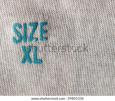 real macro of XL size clothing label - stock photo