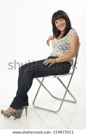 real middle aged woman posing over a white background