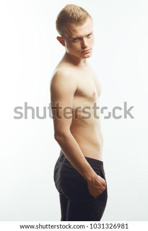 Real natural male beauty concept. Handsome charismatic young man posing over white background. Trendy hipster haircut. Fashion studio shot