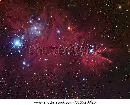 Real Nebula and star cluster called Cone Nebula and Christmas Tree Cluster in Monoceros taken with CCD camera through medium focal length telescope - stock photo
