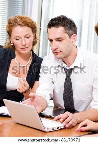 Real office worker posing for camera in Hi Res - stock photo