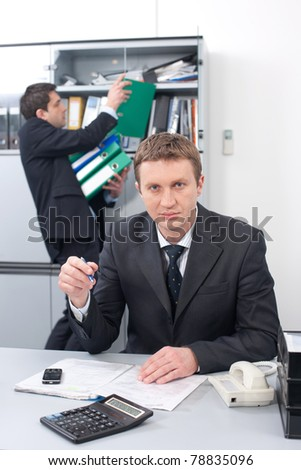 Real office worker posing for camera in Hi Res