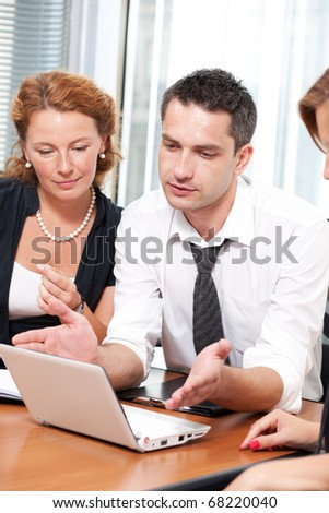 Real office workers posing for camera in Hi Res - stock photo