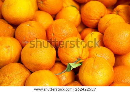 real organic oranges at market stall - stock photo