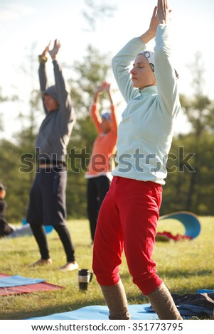 Real outdoor seminar. Group is practicing Qi Gong - stock photo