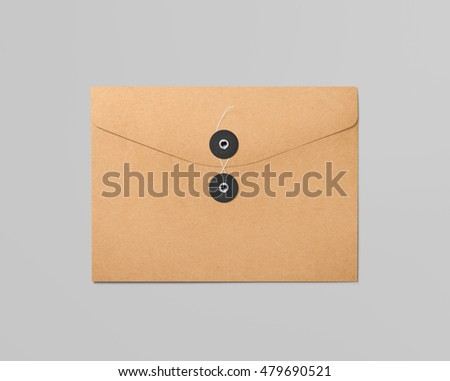 Real photo, cardboard envelope, isolated on grey to replace your design. With clipping path, isolated, changeable background.