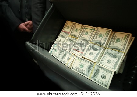 real photo of bag with one million dollars US - stock photo