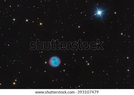 Real Planetary Nebula called Owl Nebula or Messier 97 in the constellation Ursa Major taken with CCD camera through medium focal length telescope - stock photo