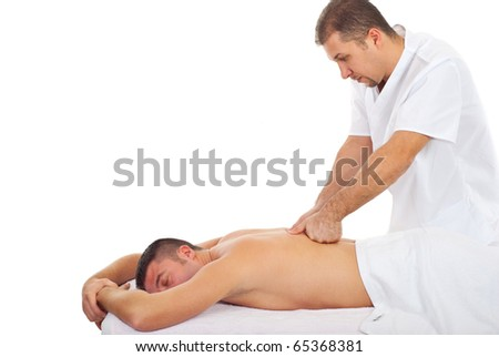 Real professional masseur giving deep back massage to a man in a spa resort - stock photo
