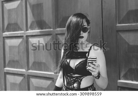 real punk girl with smartphone  - stock photo