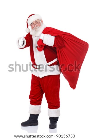 real Santa Claus carrying big bag and showing ok, isolated on white background - stock photo