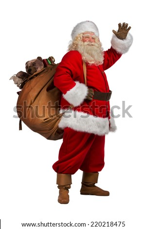 Real Santa Claus carrying big bag full of gifts, isolated on white background. Full length portrait - stock photo