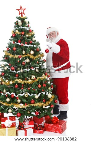 real Santa Claus holding Christmas ball and decorating  Christmas tree, isolated on white background - stock photo