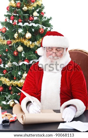 real Santa Claus writing list gifts on old paper scroll, isolated on white background - stock photo