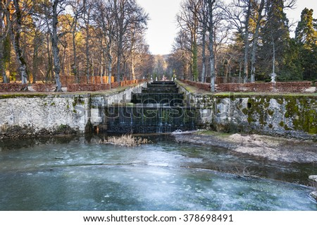 REAL SITIO DE SAN ILDEFONSO - JANUARY 4, 2015: Fountain in the gardens of the Royal Palace of La Granja de San Ildefonso, Segovia, Spain, on January 4, 2015 - stock photo