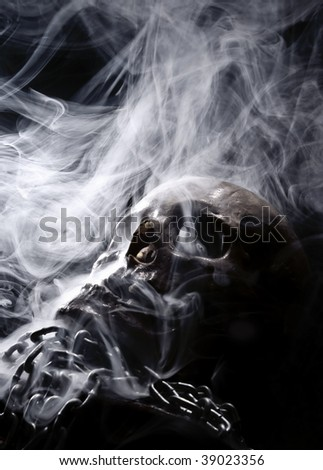 real skull in abstract smoke - stock photo