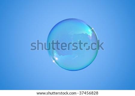 Real soap-bubble on the blue sky - stock photo