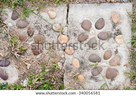 Real stones in cement wall
